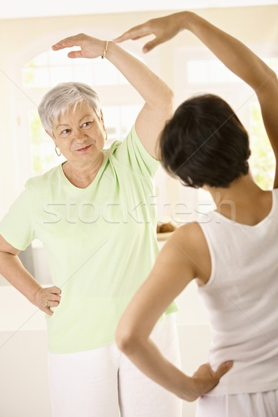 Senior woman with personal fitness trainer Stock photo © nyul