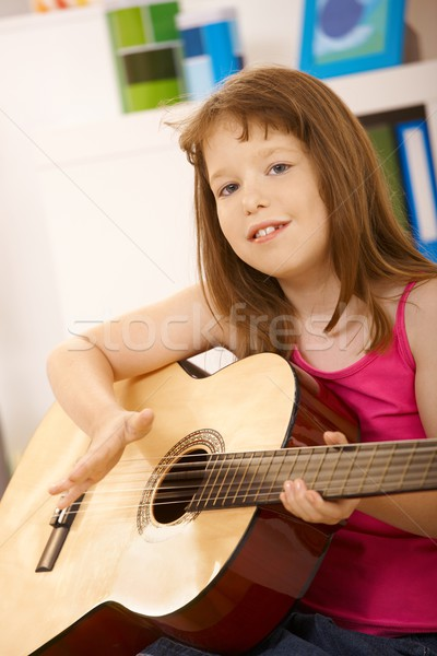 Stock photo: Portrait of little girl with guitar