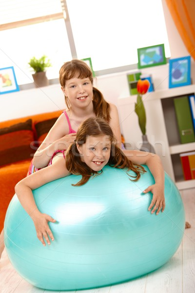 Girls playing with gym ball in living room Stock photo © nyul