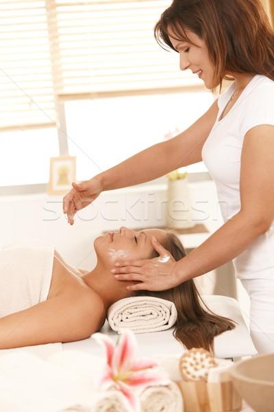 Masseur applying cream on face Stock photo © nyul