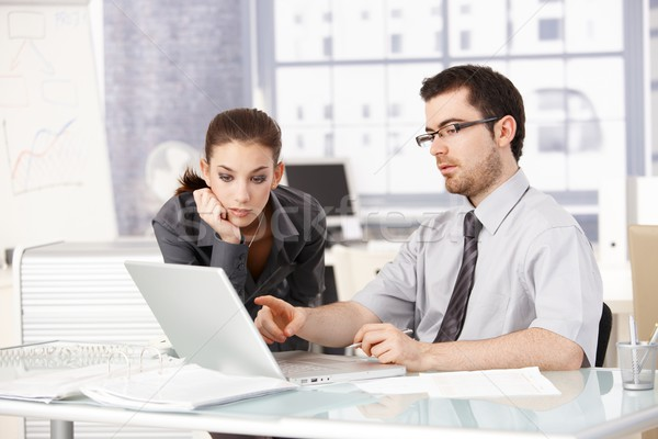 Stock photo: Young man and woman working together in office