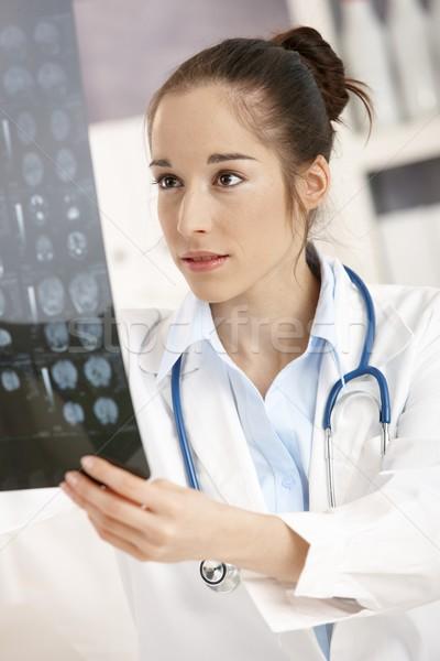 Genç kadın doktor ofis oturma büro Stok fotoğraf © nyul