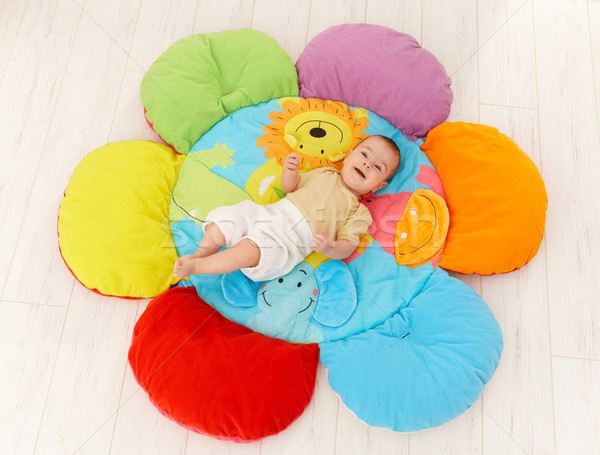 Happy baby on playmat Stock photo © nyul