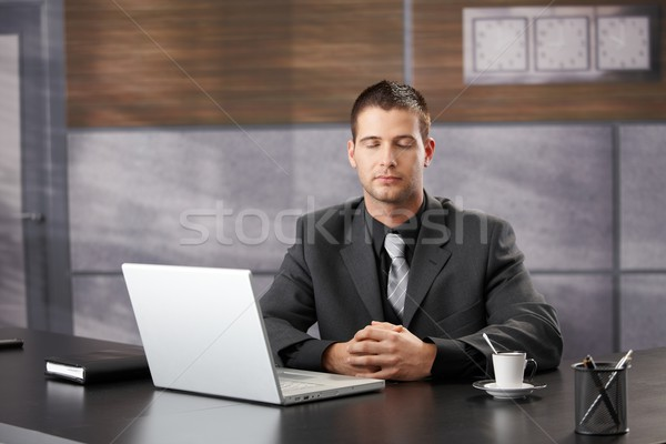Top manager meditating in elegant office Stock photo © nyul