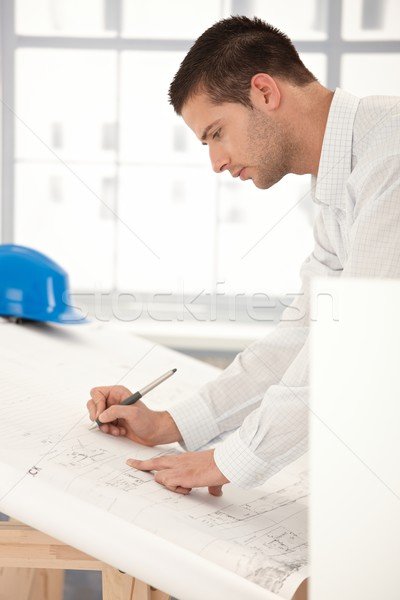 Young engineer making plans Stock photo © nyul