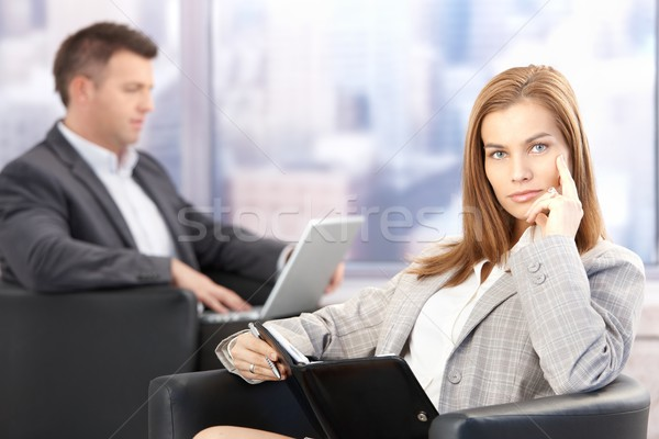 Attractive businesswoman sitting in office lobby Stock photo © nyul