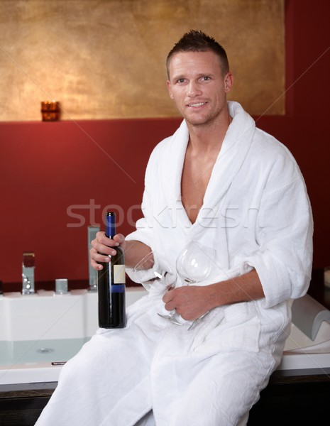 Happy man at jacuzzi with wine glasses Stock photo © nyul