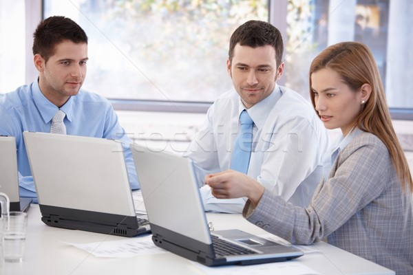 Stock photo: Attractive businesspeople working together smiling