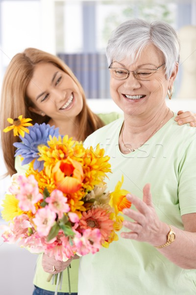 Elderly woman and daughter smiling happily Stock photo © nyul