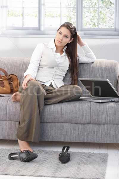 Weary businesswoman sitting on sofa Stock photo © nyul