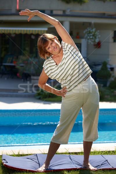 Aktív idős nő boldog edzés testmozgás Stock fotó © nyul