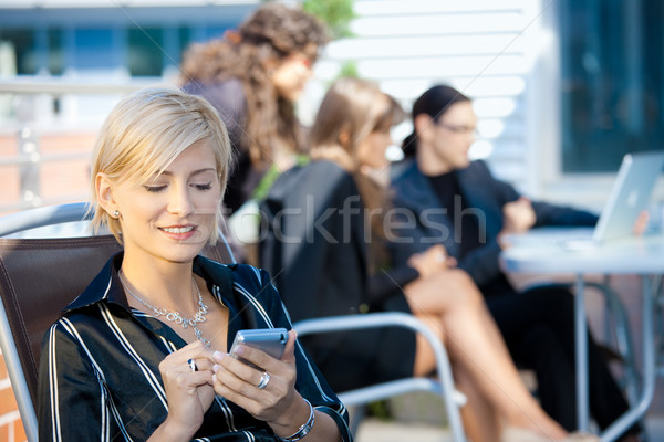 Stock photo: Businesswoman using smart phone