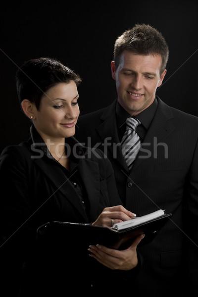Business glimlachend tevreden naar notebook Stockfoto © nyul