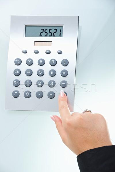 Female hand using calculator Stock photo © nyul