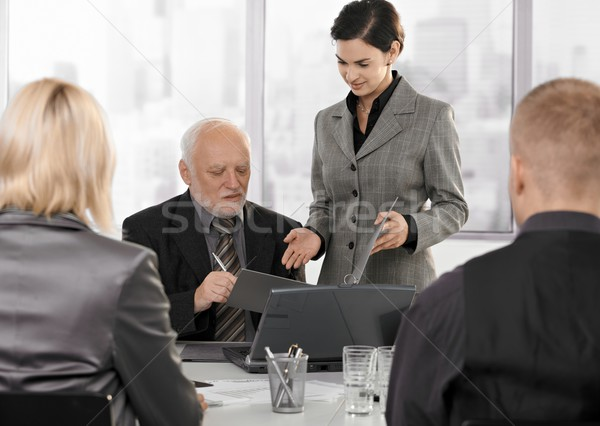 Secretary getting contract to sign by executive Stock photo © nyul
