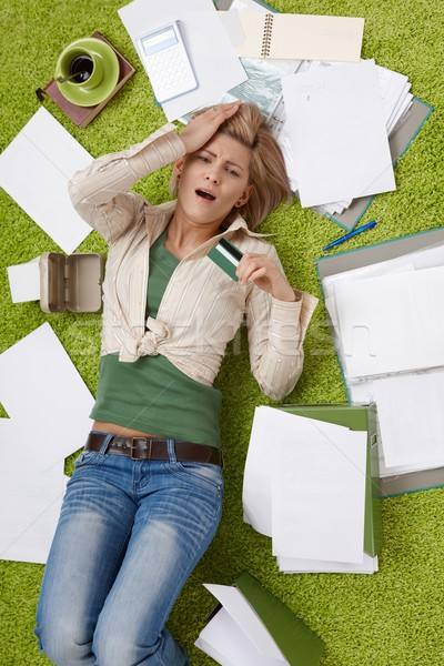 Shocked woman on floor with bills Stock photo © nyul