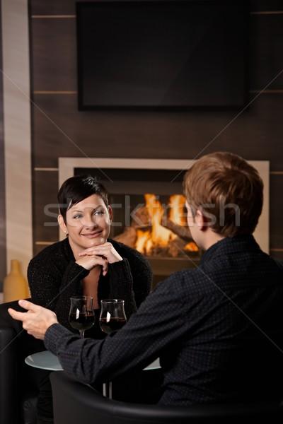 Romantische paar dating jonge vergadering haard Stockfoto © nyul