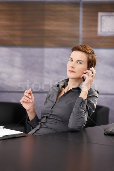 Portrait of serious businesswoman on phone Stock photo © nyul