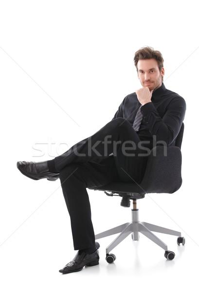 Stok fotoğraf: Işadamı · oturma · sandalye · yakışıklı · gülen · iş