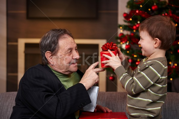Small boy giving present to grandfather at christmas Stock photo © nyul
