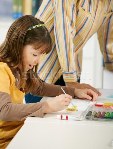 Schoolgirl painting in art class at elementary school Stock photo © nyul