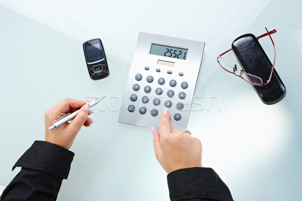 Female hands using calculator Stock photo © nyul