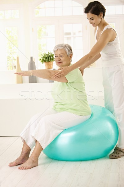 Senior woman doing fit ball exercise Stock photo © nyul