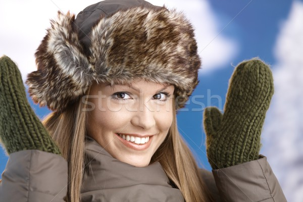 Attractive girl dressed up for winter fun smiling Stock photo © nyul