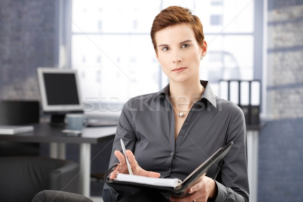 Severe young businesswoman at work Stock photo © nyul