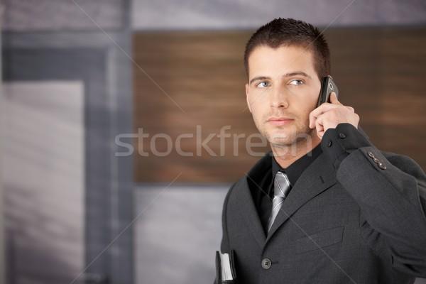 Handsome businessman on phone Stock photo © nyul