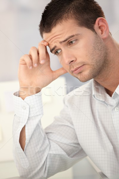 Goodlooking man having headache Stock photo © nyul