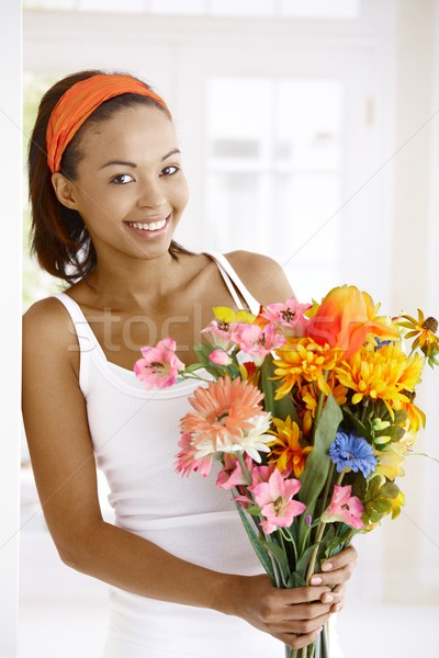 Happy woman with flower bouquet Stock photo © nyul