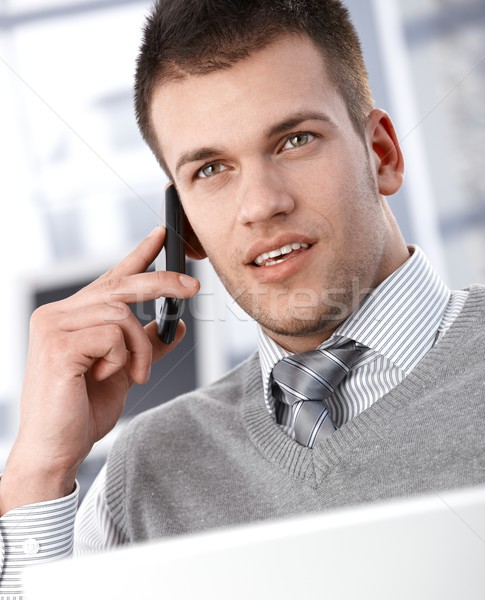 Goodlooking businessman talking on mobile phone Stock photo © nyul