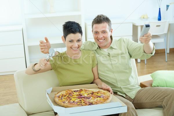 Stok fotoğraf: Mutlu · çift · yeme · pizza · oturma · kanepe