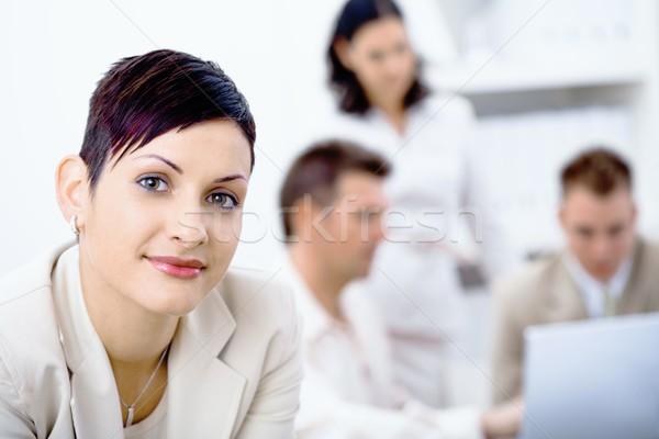 Mujer de negocios pie frente mirando cámara sonriendo Foto stock © nyul
