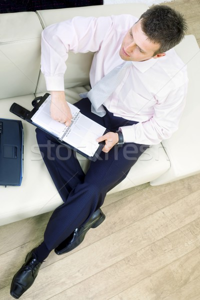 Businessman sitting on couch Stock photo © nyul