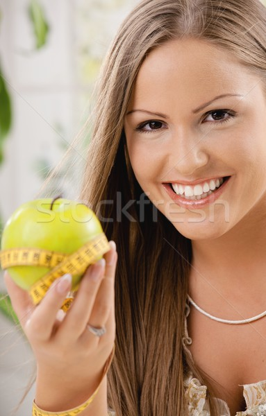 Happy young woman on diet Stock photo © nyul
