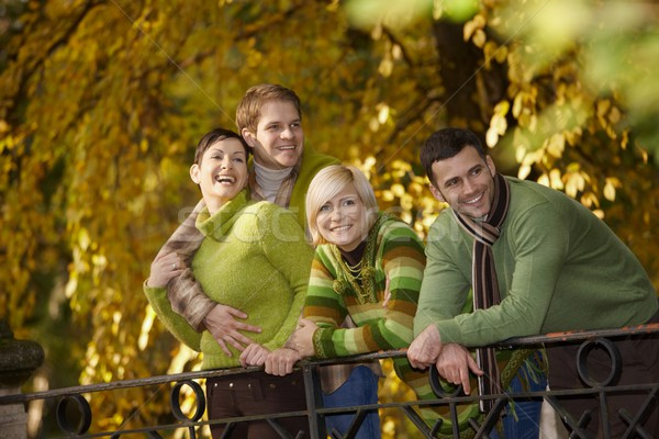 Happy young people in autumn park Stock photo © nyul