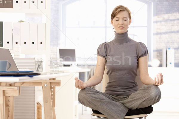 Attractive office worker practicing yoga Stock photo © nyul