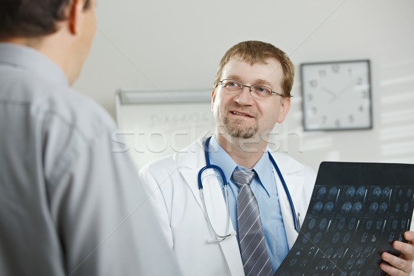 Doctor explaining to patient Stock photo © nyul