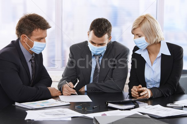 Uomini d'affari h1n1 virus influenza indossare Foto d'archivio © nyul