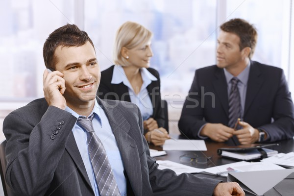 Businessman on call in office Stock photo © nyul