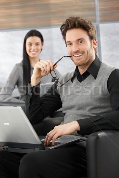 Guapo empresario sonriendo jóvenes sesión oficina Foto stock © nyul