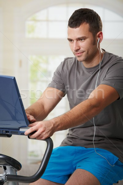 Man doing exercise at home Stock photo © nyul
