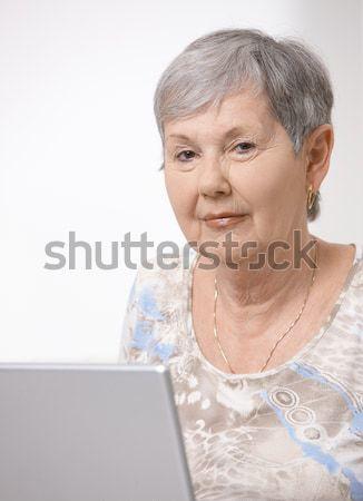 Stock photo: Senior woman using laptop computer
