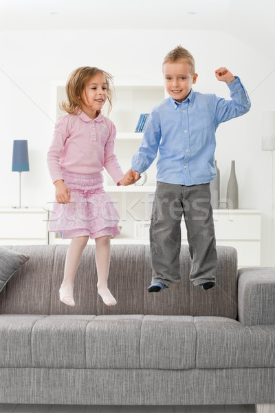 Children jumping on couch Stock photo © nyul