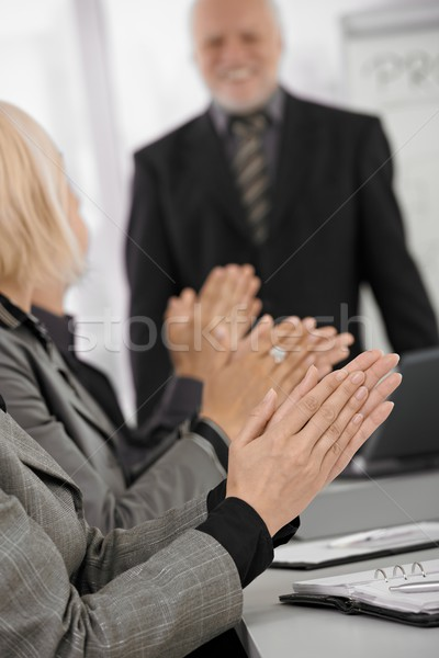 Clapping hands in focus on businessmeeting Stock photo © nyul