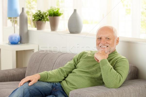 Ritratto pensionato divano seduta home sorridere Foto d'archivio © nyul