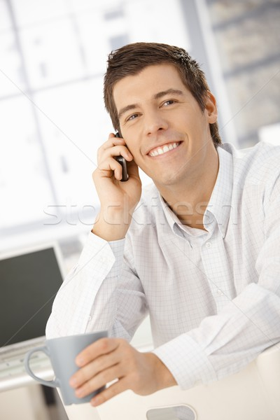 Happy businessman on phone call Stock photo © nyul