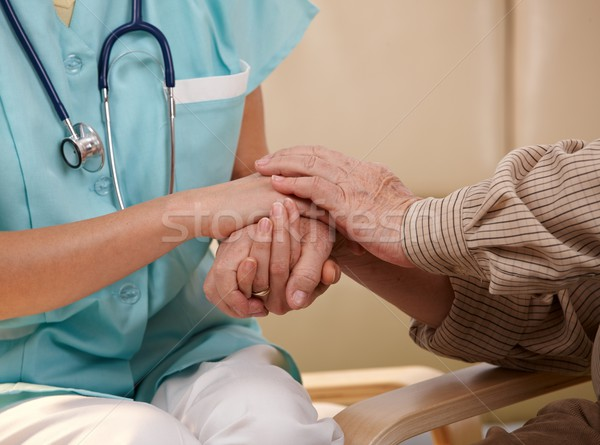 Hands of nurse and elderly patient. Stock photo © nyul